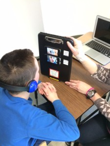 Student using iPad/iPod creation for video modeling.